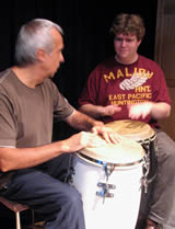 Jorge Santo giving a conga drum lesson